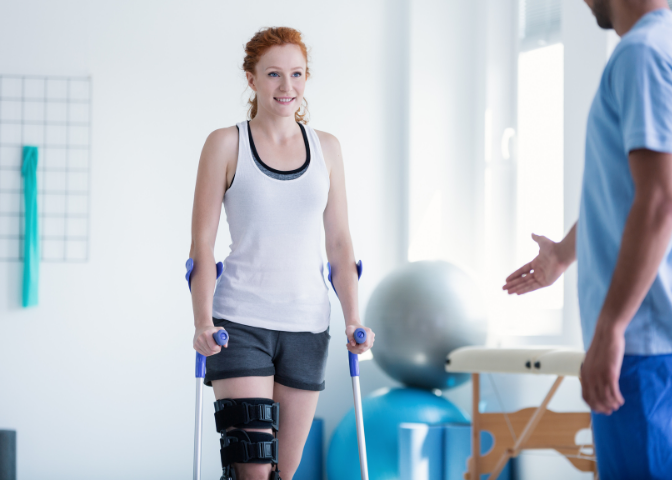 HSCP Physiotherapist helping a young female patient with her rehabilitation